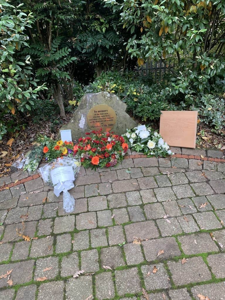 Rail Memorial Garden with plaque and flowers from survivors and family and friends of victims as well as Hatfield Community